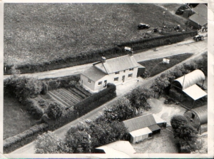 Aerial view of the House and Buildings circa 1960
